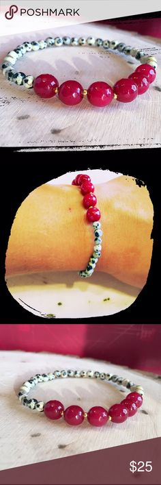 Dalmatian and Red Stretch Bracelet This color combination is so beautiful! Beautiful Red Beads paired with small Dalmatian beads. Tiny gold accents make it easy to pair with other jewelry or watches! The Spotted Bead Jewelry Bracelets
