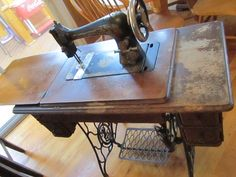 JUST like my Gramma's that was stolen from the house :o( Me wants another one.....Antique Treadle Singer Sewing Machine and Cabinet. $100.00, via Etsy.