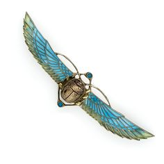 Plique-a-Jour Enamel Egyptian Revival Scarab Brooch in Silver. With a wingspan of 4 and 3/4 inches, this soaring Egyptian Revival scarab brooch - circa 1920s - glows with translucent turquoise blue and shaded green plique-a-jour enamel. Crafted in 800 silver (possibly German or Austrian origin) - exotically striking and beautiful.