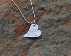 """Pendants come in a variety of shapes and will hold a single print on the fron. Your loved one's name will be engravd on the back. This pendant comes on a 16"""" sterling silver chain, we also have several lenghts and styles available http://silverhavenjewellery.com/products/224237--single-print-pendant.aspx"""