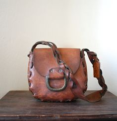 Vintage 1960s Tooled Leather & Brass Bag by REBOOTVINTAGE on Etsy, $65.00