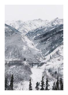 Train rail through snowy mountain pass poster