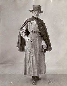 World War I Red Cross Public Nurse's Uniform When she is at work in her district, the Red Cross Public Nurse wears the practical gray cotton crepe working uniform, with regulation hat and cape. Photographed by Joel Feder. Nursing Pictures, Medical Pictures, World War One, First World, History Of Nursing, Medical History, Vintage Nurse, Happy International Women's Day, Edwardian Fashion
