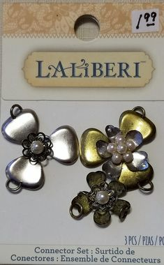 E-178, $3.25, Three Mixed Colored Metal Flowers Accented with Faux Pearls with Two Connectors are Attached to Each Flower