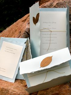 Blue imported handmade deckle edge invites with real painted leaves.  Paper available in different colors.