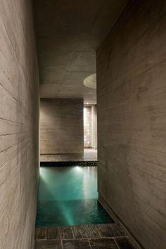 Pinewood-shuttered-concrete provides a warm texture to the interior of A4 Estudio's Entre Cielos spa in Mendoza, Argentina
