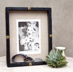 custom dog art as memorial with collar in frame by candle sitting on table