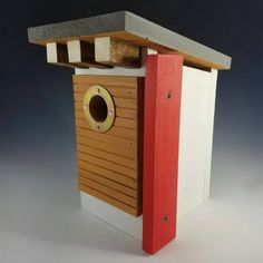 This is a selection of bird boxes that will make your garden home to the best box on the block. Welcome the birds to your abode with these stylish bird house designs. Cool Bird Houses, Decorative Bird Houses, Birdhouse Designs, Diy Birdhouse, Modern Birdhouses, Bird Aviary, Bird Boxes, Midcentury Modern, Bird Feeders
