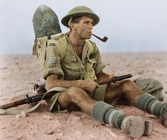 Colourised Photos New Zealand Army Sergeant Ian Thomas smoking a pipe during the North African Campaign in Egypt Battalion, Infantry Brigade, NZEF. (National Library of NZ Ref. Object pin by Paolo Marzioli Military Photos, Military History, North African Campaign, Ww2 Uniforms, Army Sergeant, Man Of War, War Photography, World War Ii, Wwii
