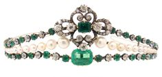 Edwardian emerald pearl and diamond tiara c1910's Silver, 18k yellow gold and 14k white gold and set with 5 ct mixed emerald & cushion cut emerald (12.3 mm x 10.0 mm) in the centre, probably Russian with an approx. 1 ct emerald, probably Colombian. 32 additional emeralds of total weight approx. 4.50 cts, + approx. 7.80 cts diamonds (Old European cut and cushion cut) and 39 natural pearls (6.8-2.9 mm)
