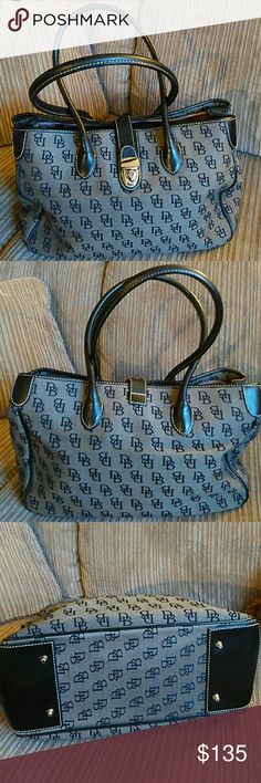 SPECIAL PURCHASE  HAND/SHOULDER/TOTE BAG LIKE NEW DOONEY & BOURKE  AUTHENTIC COLOR BLACK INSIDE OF BAG HAS 2 ZIP POCKETS & 1 OPEN POCKET  NO RIPS OR STAINS INSIDE OR OUTSIDE OF BAG  MINOR SCRATCHES ON FRONT CLOSURE HARDWARE CLASP  MEASUREMENTS ARE 10 INCHES TALL 15 INCHES WIDE Dooney & Bourke Bags Shoulder Bags