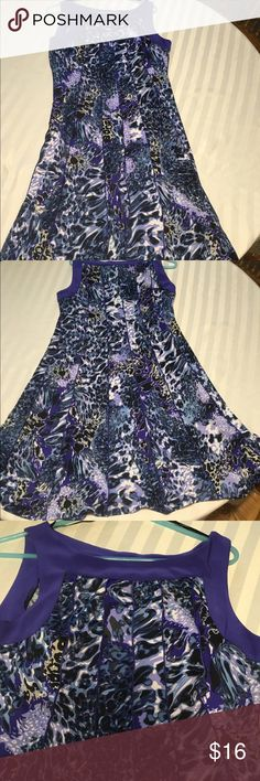 Purple multicolored sleeveless dress This dress was worn only a few times  & has pleats going down it with a full skirt. Colors are radiant. It is a size 10. Perceptions Dresses Midi