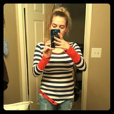 Super cute top Navy blue and white stripe with red on the sleeves and cut out on the bottom one side has buttons very fitted super cute Tops Tees - Long Sleeve