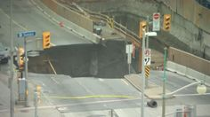 Large sinkhole closes a busy downtown street in Canada's capital city, Ottawa. Rough Cut (no reporter narration).