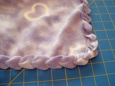 "I really like the edging on this. Fleece and Jersey knit do not technically need an edge since they do not ravel, however, this looks really nice. Pieces by Polly Single Layer No-Sew ""Braided"" Fleece Blankets Tutorial Cute Crafts, Crafts To Make, Diy Crafts, Fabric Crafts, Sewing Crafts, Sewing Projects, Fleece Projects, Braided Fleece Blanket Tutorial, No Sew Fleece Blanket"