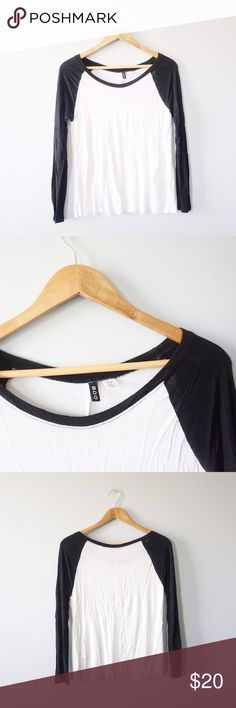Urban Outfitters BDG Baseball Tee Urban Outfitters brand BDG black and white baseball tee size small. Sheer and lightweight. 22 inches long, 17.5 inch bust. Rayon and spandex. No stains or holes. Urban Outfitters Tops Tees - Long Sleeve
