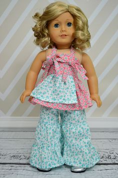 "Create Kids Couture proudly offers Bridgette's Palazzo Pants/Capri and Lucy's Apron Knot Dress pdf sewing pattern. This includes measurements for both 15"" and 18"" dolls. Think of how stylish your daughter and her doll can be in these mommy made clothes!"