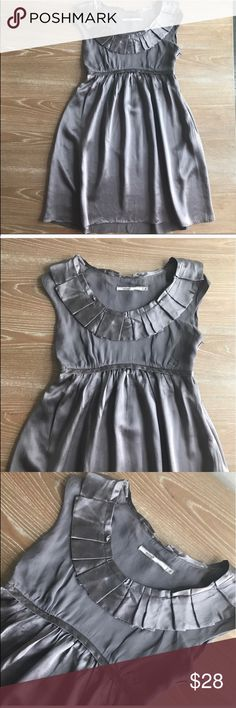 """SATIN PEWTER RUFFLE DRESS 💗Condition: EUC, No flaws, no rips, holes or stains. Color is a gray silver: pewter. Bust: 33"""", length: 34"""". Satin fabric.  💗Smoke free home/Pet hair free 💗No trades, No returns. No modeling  💗Shipping next day. Beautiful package! 💗I LOVE OFFERS, offer me! 💗ALL ITEMS ARE OWNED BY ME. NOT FROM THRIFT STORES 💗All transactions video recorded to ensure quality.  💗Ask all questions before buying #45 Mint Dresses Mini"""