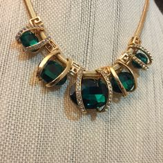 Gold drop necklace with Emerald colored stones.,lined with Crystal gems.. Make it the center of any conversation. · Statement Necklace