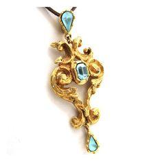 C.LACROIX, pendentif en métal doré vintage