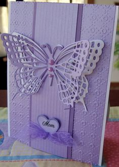 handmade Mother's Day card ... monochromatic lavenders ... gorgeous die cut butterfly from Marianne Dies ... lots of texture from two different texture plates ...