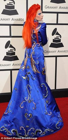 The works: Gaga's flame-colored wig fell down her back to her waist over the night sky motif of her designer dress that flowed out behind her as she walked