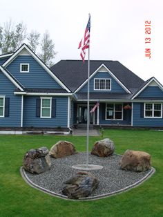 Our front yard with our new flag pole.
