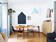 Cute Scandinavian style dining room with pops of color