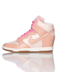 NIKE Womens high top sneaker Lace up clousre All-over glitter material Padded tongue with NIKE logo Signature swoosh on side of shoe Cushioned sole