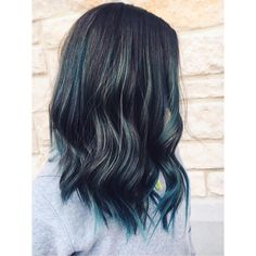 Cool dark blue-green Aveda hair color from Lemongrass Salon & Spa.