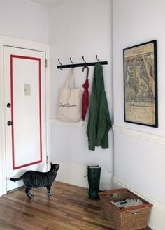 Having hooks right behind the door is a clever way of using the most of small space