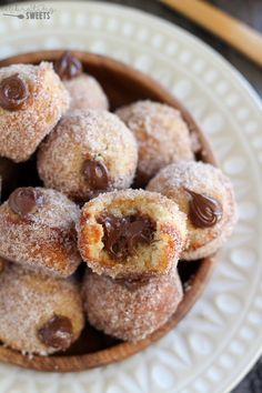 Nutella Stuffed Cinnamon Sugar Donut Holes - Baked vanilla donut holes coated in cinnamon sugar and filled with creamy Nutella. No frying necessary!