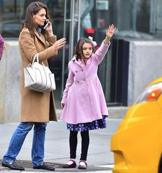 Good genes! Katie Holmes was spotted hailing a cab with her lookalike daughter Suri, 10, in New York City on Tuesday