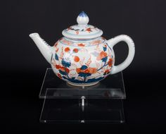 Description A small Chinese bullet teapot & cover In Kangxi 'Chinese Imari' style, typically decorated in iron red & underglaze blue with flowering peony.  Date 20th century   www.collectorstrade.de