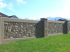 Concrete stone fence But I would want it much taller
