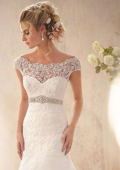 Wedding Gowns by Morilee featuring 2620 Alençon Lace Appliqués and Wide Hemline on Net with Crystal Beaded Empire Colors Available: White/Silver, Ivory/Silver. Sizes Available: 2-28.
