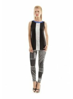 A bold optical print lends eye-catching appeal to these graphic pants from Conquista. Crafted in silkily soft viscose and elastane for a perfect fit while a wide solid colour waistband flatters the fi Color Blocking, Colour Block, Printed Pants, White Fashion, Fashion Pants, Dress Making, Perfect Fit, Pajama Pants, Black And White
