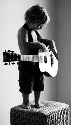 A cool boy and his guitar. Future rock star!