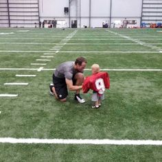 """I don't care if you aren't a Saints fan this is absolutely adorable! """"@drewbrees: Bowen wanted me to strap the pads on him after practice today :-)"""" <3"""