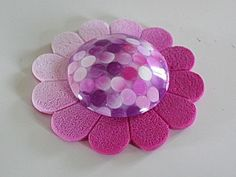 The tutorial shows how to create the dotted dome in the center of this polymer clay flower. By a French blog called Bounette.
