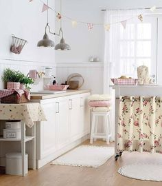 Kitchen - pale blue wtih red and white floral prints.
