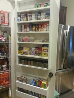 Shelves on inside of pantry door.