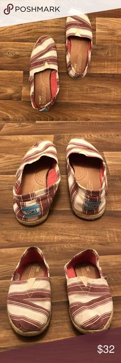 > MAKE AN OFFER -TOMS - Striped Espadrilles < TOM'S Maroon Striped Espadrilles   -Worn 2-3 times  -In great condition, minor wear on bottom and inside (as shown) -The colors are a shade of burgundy/maroon and cram  -EXTREMELY COMFORTABLE  *PLEASE NOTE SIZE: I am a TTS 7 in the TOMS classic canvas shoe (they run smaller).  So I always purchase a half size smaller in the espadrilles style!*   Happy shopping! TOMS Shoes