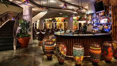 Created by Gloria and Emilio Estefan, Bongos Cuban Cafe features fiery Latin rhythms and authentic Cuban cuisine in Disney Springs Westside. Restaurant Game, Cuban Restaurant, Havana Nights Party Theme, Havana Bar, Cuban Cafe, Cafe Cubano, Orlando Restaurants, Restaurant Interior Design, Bar Lounge
