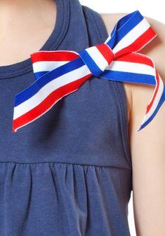 TOPitm , het online kinderkleding label voor betaalbare stoere meisjes kleding.::TOPitm strik rood,wit en blauw