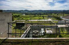 Galería de Casa LEnS / Obra Arquitetos / Exterior space / Green Terrace House / Exterior View /