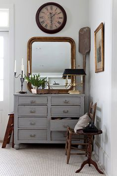 Love the shape of this gold mirror, beautiful texture of the rug and gorgeous grey chest of drawers