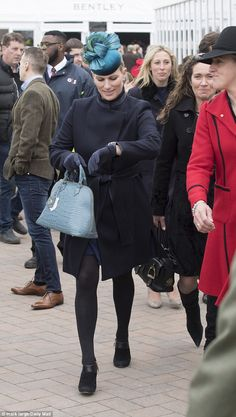 The mother-of-one looked chic in a navy coat as she arrived for the first day of the Cheltenham Festival just days after competing at the Tweseldown Horse Trials in Hampshire.