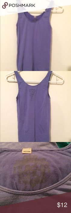 🎀just in Juicy Couture stretch tank Must admit this lavender top a big favorite by Juicy Couture, last photo shows the logo but it's washed into fabric, see 2nd pic where you can see the logo from outside -perfect other than this -price reflects discount, it's a nice long very stretchy tank with same color striping XS Juicy Couture Tops Muscle Tees
