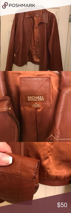 Michael Kors leather jacket Lovely Michael Kors brown leather jacket. I purchased from another posher and never used it because it's too big on me. It's a medium but fits like a large. There is a small hole in the right arm pit from previous owner that can be easily fixed. There is slight darkening on the sleeve edges and neck from being against the skin. Dry cleaning would probably fix that but not real noticeable anyway. Michael Kors Jackets & Coats